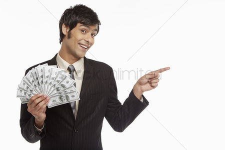 Masculinity : Businessman holding money and pointing to the left