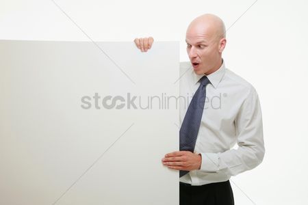 Bald : Businessman holding white placard