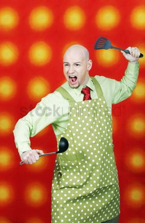 Bald : Businessman in apron holding spatula and ladle