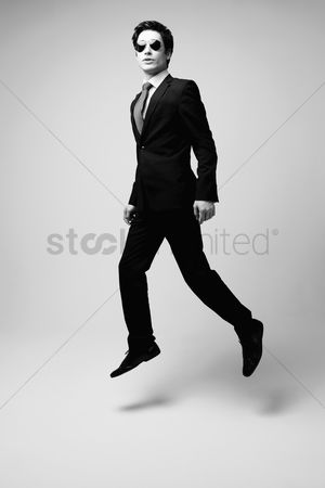 Man suit fashion : Businessman in full suit jumping in air