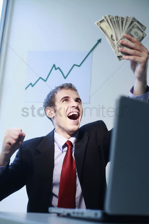 Loss : Businessman laughing while looking at banknotes