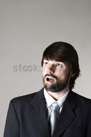Amazed : Businessman looking up
