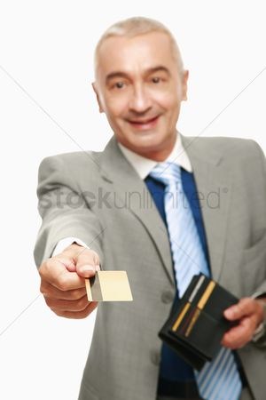 Spending money : Businessman making payment with his credit card