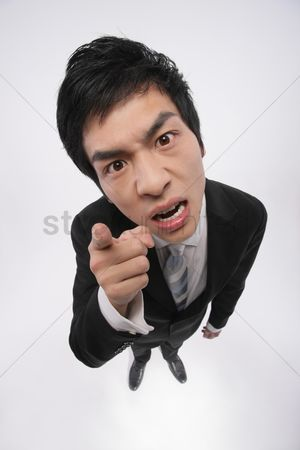 Rage : Businessman pointing and scolding