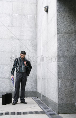 Composed : Businessman posing for the camera