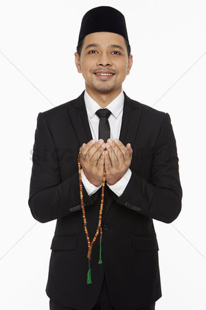 Rope : Businessman praying with prayer beads