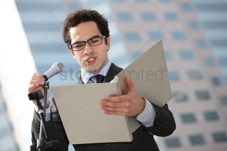 Leadership : Businessman reading speech from document