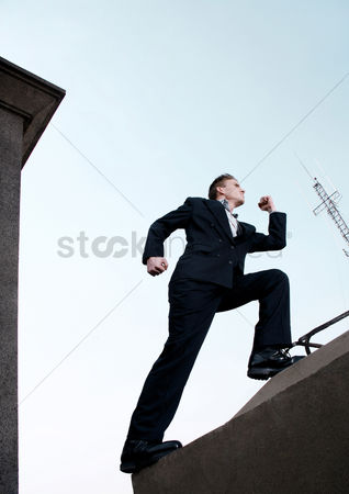 Strong : Businessman running up the stairs