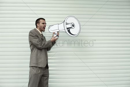 Cardboard cutout : Businessman shouting through megaphone