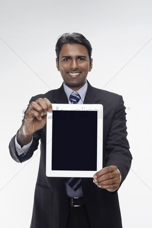 Portability : Businessman showing digital tablet