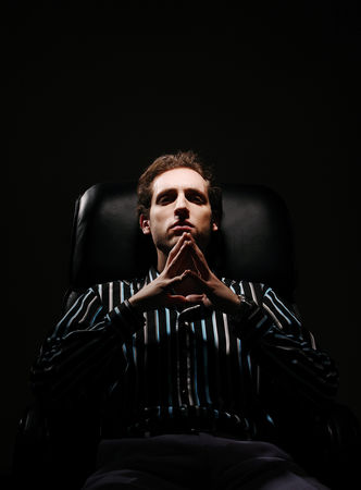 Thought : Businessman sitting on the chair thinking