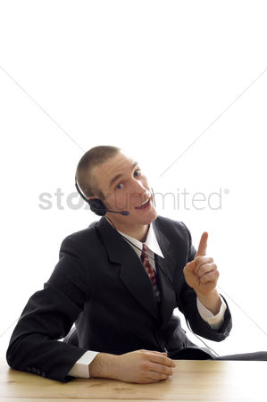 Business suit : Businessman talking on telephone headset