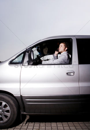 Cellular phone : Businessman talking on the phone while driving in the car