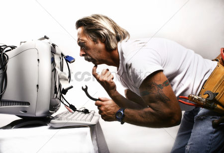 People : Businessman trying to fix his computer