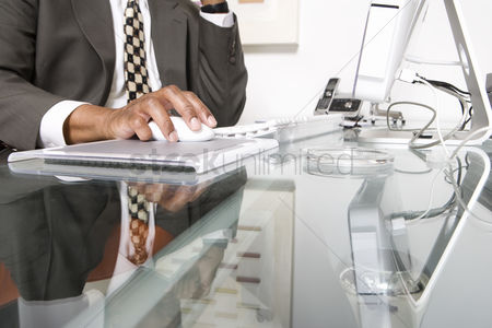 Furniture : Businessman using a mouse