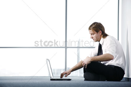 Determined : Businessman using laptop