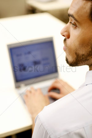 Internet : Businessman using laptop