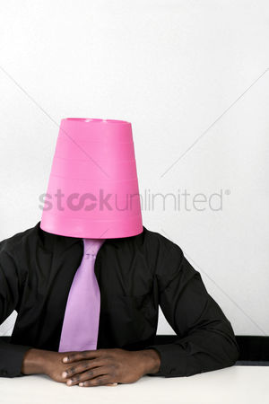 Funny : Businessman with a dustbin covering his head