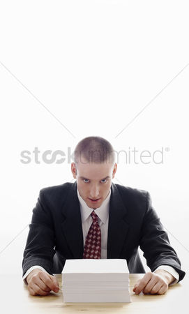 Mad : Businessman with a stack of papers on the table