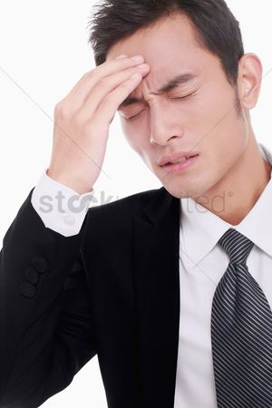 Frowning : Businessman with hand on his head