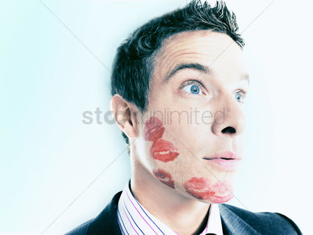 Kissing : Businessman with lipstick kiss-marks