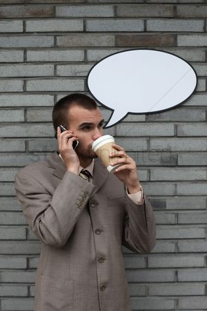 Cardboard cutout : Businessman with speech bubble talking on the phone and drinking coffee