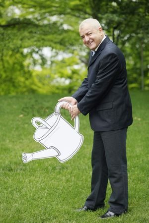Cardboard cutout : Businessman with watering can