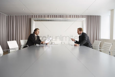 Spacious : Businessmen discussing in boardroom