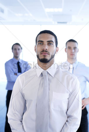 Corporation : Businessmen posing for the camera