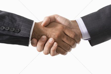 Two people : Businessmen shaking hands close-up on hands