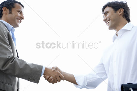 Business suit : Businessmen shaking hands side view