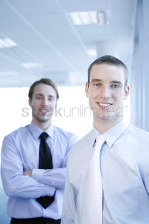Smiling : Businessmen smiling at the camera