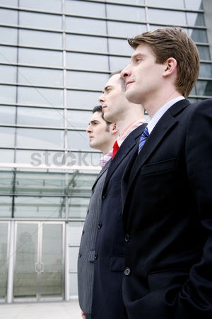 Man suit fashion : Businessmen standing straight in a row