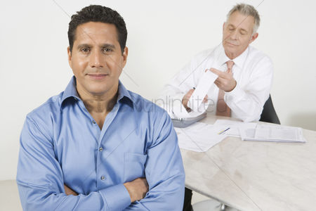 Hispanic : Businessmen working in office