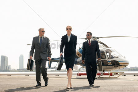 Transportation : Businesspeople arriving from helicopter