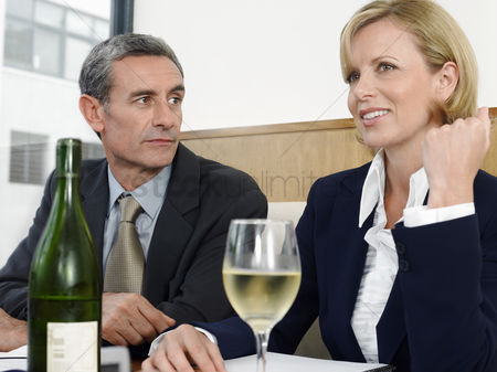 Wine bottle : Businesspeople with wine in restaurant