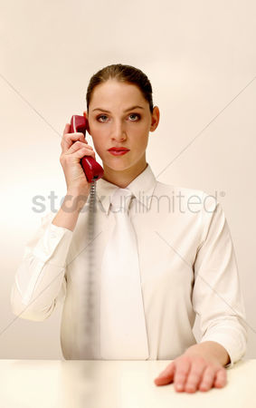 Answering calls : Businesswoman answering a phone call