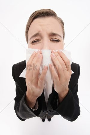 Blowing : Businesswoman blowing her nose