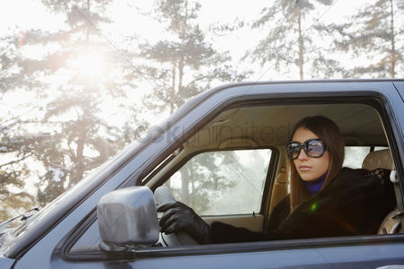 Cold temperature : Businesswoman driving on winter day