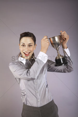 Amazed : Businesswoman holding trophy portrait