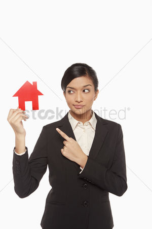 Malaysian indian : Businesswoman holding up a cut out house