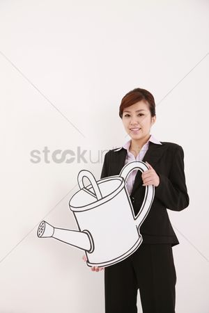 Cardboard cutout : Businesswoman holding watering can