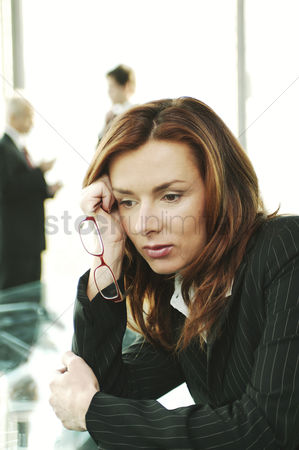 Thought : Businesswoman in deep thought