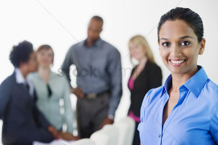 Posed : Businesswoman in meeting