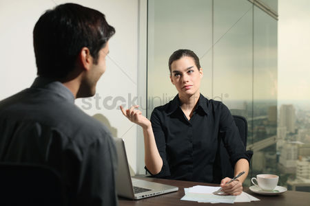 Two people : Businesswoman interviewing a candidate