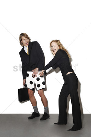 Shyness : Businesswoman laughing at her colleague