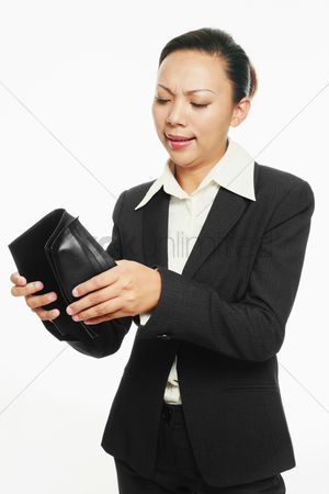 Frowning : Businesswoman looking into her wallet