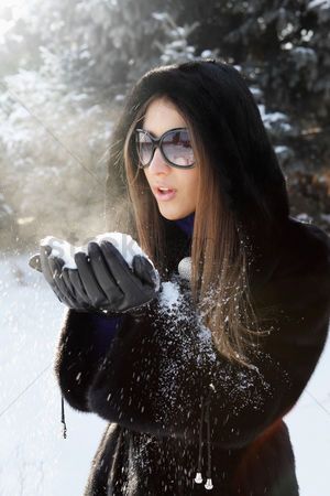 Blowing : Businesswoman playing with snow