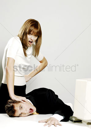 Pushing : Businesswoman pressing her colleague s face against the table