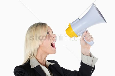 British ethnicity : Businesswoman shouting into megaphone